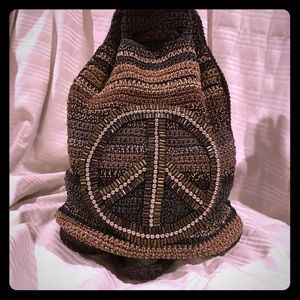 The Sak drawstring backpack with peace sign